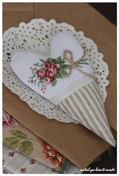 Pretty cross-stitched heart. ~ Lovely way to reuse vintage needlework. Just think; you could make many of these from one piece for grandmas linens and share them with your whole family!! Cross Stitch Finishing, Cross Stitch Flowers, Cross Stitch Heart, Valentine Heart, Ribbon Embroidery, Cross Stitch Embroidery, Needlepoint, Sachets, Beautiful Hearts