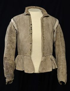 (MoR 20535-1) Doublet. 1575-1621, Dutch. Museum Rotterdam, Netherlands. 2 pictures  Doublet of Hugo Grotius, goatskin with snags, grommet & bubbles. Lining of coarse linen, fronts are firmly padded. Button fastening w/pewter buttons, 6 present. 29 buttonholes. Seams are finished w/a green woven silk decorative band that has disappeared in many places. On the inner side sits on a strip of cloth with the waist grommet for the fastening of the pants.