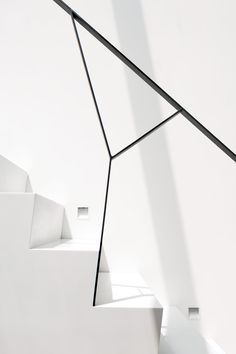 The staircase to the uppermost level is white Corian.