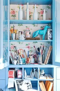 Pretty wallpaper at the back of a cabinet.  Home of Ruthie Sommers, californian designer.