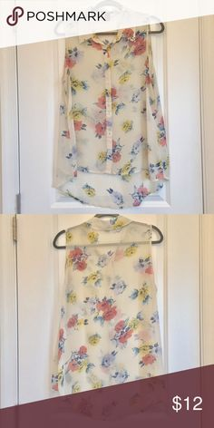 Off white floral sleeveless sheer top size L Forever 21. Size L. Buttons from collar all the way down. Floral designs. Slightly sheer. Worn a couple of times only, no stains or tears. From a smoke free home. Forever 21 Tops Blouses