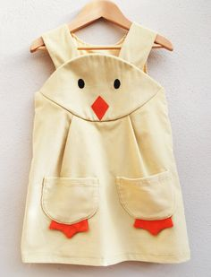 The perfect Spring dress for little girls ages 3 months to 6 years old, Wild Things Dresses' Spring chick dress ($60) is made of cotton corduroy and features a classic pinafore shape with a chick face on the front yoke and matching duckling feet pockets.