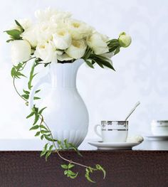 Flowers: this centerpiece runneth over with garden roses, peonies, and a romantic tendril of jasmine vine