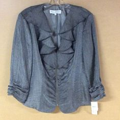 Donna Degnan after 5 jacket Donna Degnan after 5 gray metallic zip up jacket. Ruffle front with 3/4 scrunch sleeves. New with tags!! This is a gorgeous jacket! Made in New York. Donna Degnan Jackets & Coats Blazers