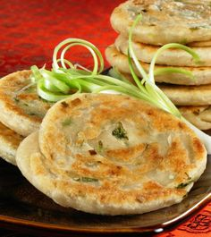 """Scallion Pancakes: Makes: about two dozen 2- to 3-inch pancakes  1 cup whole wheat pastry flour or spelt flour, or a combination 1 cup plus 2 tablespoons rice milk or water 1/2 teaspoon salt 1 cup thinly sliced scallions 2 tablespoons sesame seeds (optional) Olive oil or other healthy vegetable oil """"Duck"""" Sauce, if desired"""
