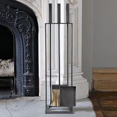 Doesn't need to be this specific one, but a fireplace tool set! Right now there's lots of reaching in with bare hands. Black or brass would match our fireplace.