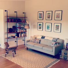 """Living room with shelves we made from 3/4"""" black steel pipe."""