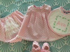 Dress, bloomers, booties and personalized bib.