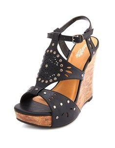 Studded cutout wedge sandal.