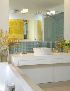 """Porcelain tiles, white lacquered cabinets and turquoise glass tile. The painting is Roblin's """"Spa"""" from his """"Wallseries.""""    Sink and soaking tub: Duravit; mirror and glass-enclosed shower: Victoria Glass; vanity lighting: Artemide"""