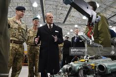 HRH The Duke of Edinburgh   speaks to army personel in a Land Rover workshop during a visit the new home of REME to be named 'The Prince Philip Barracks' at MOD Lyneham in Wiltshire south west England, on March 11, 2016. / AFP / ...