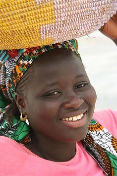 Young banana salesgirl  - A smile from Senegal, Africa, by Ferdinand Reus, via Flickr
