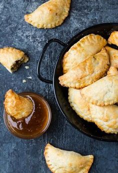 These homemade Curried Pork Empanadas can be made, assembled and even baked ahead of time - a perfect hot appetizer for busy hosts!