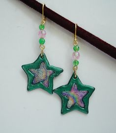 Dangle Pierced Earrings Tones of Metallic Green Pinks and Purples in Star Patterns Handcrafted Jewelry, Unique Jewelry, Star Jewelry, Pierced Earrings, Star Patterns, Purple, Pink, Whimsical, Dangles