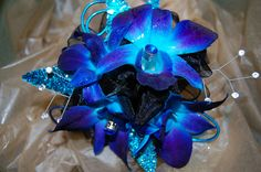 A bold corsage to stand out in any event. For more visit www.aboutflowersblog.com
