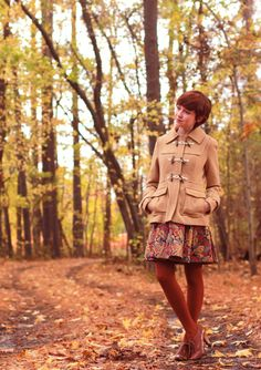 I especially love the coat and the color of the tights.
