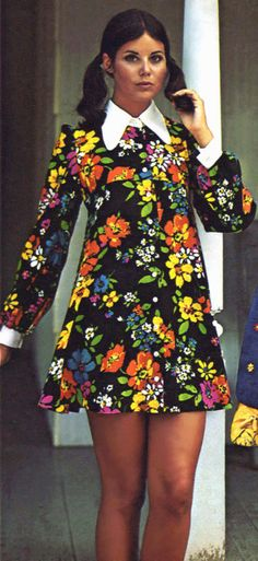 Colleen Corby in a Floral Print Dress ♥ black background red yellow blue flowers babydoll dress tab collar long sleeves mini short skirt pigtail hairstyle vintage fashion style history color print ad model 1960s Fashion Women, 60s And 70s Fashion, Fashion Mode, Vintage Fashion, 1960s Fashion Dress, Trendy Fashion, 1960s Fashion Hippie, Fashion Clothes, Hijab Fashion