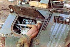 A soldier working on an M113 Armored Personnel Carrier, circa 1968.