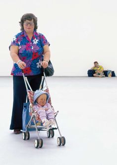 Left to right: Woman with Child in a pushchair or Stroller and a holiday Traveller at the Saatchi Gallery London in 1997