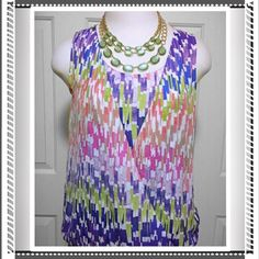 Liz Claiborne, colorful top Beautiful colorful design top that will go with any outfit. Gathers at the waist with a fold over front. Top is lightweight and breaths well. Accessories not included. Liz Claiborne Tops Blouses