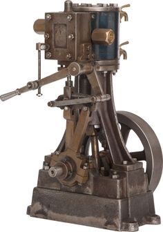 """VINTAGE STUART LIVE STEAM VERTICAL REVERSING STATIONARY ENGINE 10 x 5-1/2 x 5 inches (25.4 x 14.0 x 12.7 cm) Well engineered brass and steel 1"""" stroke reversing single-cylinder engine in original, unrestored condition."""