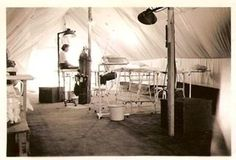 A US Army Nurse in a field surgery tent. WW2 Army