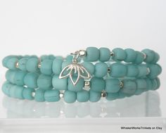 Aquamarine Memory Wire Bracelet -- Aqua Shades -- Sterling Cube Beads -- Sterling Charm -- Indonesian Modern Trade Beads -- Recycled Glass by WhiskerWorksTrinkets on Etsy https://www.etsy.com/listing/197958358/aquamarine-memory-wire-bracelet-aqua