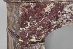 Antique fireplace made out of Fleur de Pêcher marble during the century. Regence style , this fireplace features an arched frieze with panels decor. Console-jambs shapes with flutings decor. Marble House, Marble Floor, Shades Of Purple, Cast Iron, Console, Canning, Antiques, Decor, Style
