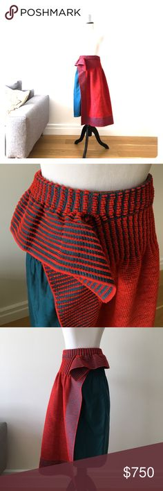 "ISSEY MIYAKE Runway - Red and Teal Skirt Authentic Issey Miyake skirt from runway show - Rare! Pre-owned mint condition as you can see from photos. Size 2, which is for length, fits like a Small or Small/Medium elastic waist. Drop dead gorgeous! 29"" long from waits and to longest edge of skirt. Textured terry-like fabric paired with teal fabric. Made in Japan. 40% cotton, 49% polyester, 1% polyurethane, 1% nylon. Dry clean only. Issey Miyake Skirts Midi"
