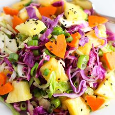 Hawaiian Coleslaw with pineapple, cabbage, carrots, sesame seeds and a ginger-soy lime vinaigrette brings a tropical taste to traditional slaw. | platingsandpairings.com