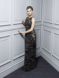 ade3cbbe17 Black evening gown fully embroidered with a lace camouflage of sequins
