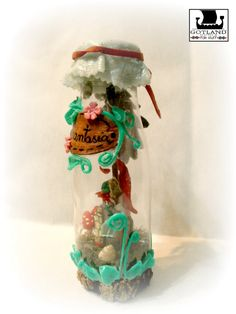 """Fantasía"" A tiny fairy house with its garden...in a bottle! OOAK  mixedmedia sculpture signed by author . . #fairy_gardens - #fairies - #jardín_de_hadas #gnome_houses - #casas_de_duendes"
