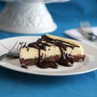 Low Carb Brownie Cheesecake Recipe - A creamy vanilla cheesecake filling atop a rich brownie crust. Two desserts in one! Low Carb and Gluten-Free - Each serving has Total NET CARBS = 4.1 g. / All Day I Dream About Food