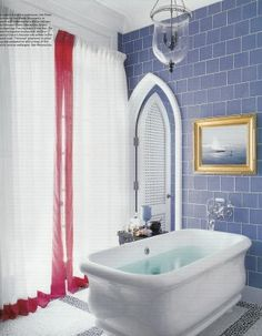 A bath in a vacation home in Vero Beach, Florida, designed by Robert Couturier, features a resin Paris tub by the Water Monopoly with wall-mounted Etoile fittings by Waterworks; the walls are sheathed with Metropol Glass tiles by Urban Archeology. Cheap Bathroom Tiles, Modern Bathroom Tile, Cheap Bathrooms, Bathroom Tile Designs, Simple Bathroom, Amazing Bathrooms, Bathroom Ideas, Bathroom Images, Blue Bathrooms