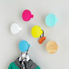 Color inspiration:  fushia, aqua, canary yellow... add a lime in there and a navy blue it it would be about perfect!    The Land of Nod   Kids Wall Hooks: Round Wall Knobs in Shelves & Wall Hooks