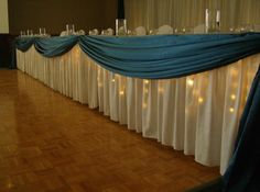 Want to make your head table really stand out? Put lighting under the tablecloth!