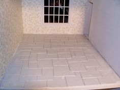 Knotty By Nature: Dollhouse stone floor on the cheap - How to spread thin coat of joint compound, score with pencil