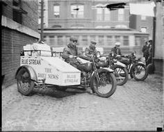 Chicago Daily News Blue Streaks members sitting on delivery motorcycles in Chicago, c. 1927. Photograph from Hedrich-Blessing. DN-0083253.