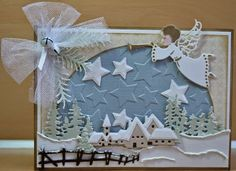 Card made by DT member Astrid with Design Folder Extra Stars (DF3408), Craftables Tiny's Pinetrees (CR1287), Tiny's Winter Village (CR1288) and Herald Angel (CR1295) by Marianne Design