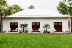 Exterior of a Hawaiian inspired house in Sullivan's Island, Charleston, South Carolina   Teak Sling Chair via Serena & Lily   Image via Remodelista