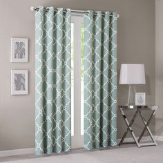 "Refresh your room with the decorative fretwork window panel. The scroll geometric print is simple yet trendy, featuring a seafoam ground with a light beige fretwork for a refreshing update. The panel is made with a cotton blend basket weave fabric softly filtering the perfect amount of sunlight into your home. Grommet top detail makes it easier to hang, open, and close panels throughout the day. Fits up to 1.25"" diameter rod."