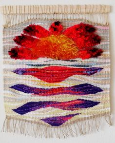 This lovely hand woven tapestry is made with natural fibers and textured yarn. Elegant and unique wall decoration.  It measures 17 x 15 inches.