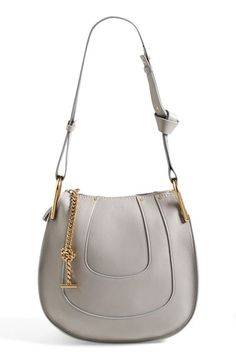Free shipping and returns on Chloé 'Small Hayley' Leather Hobo Bag at Nordstrom.com. Curvaceous detailing ornaments the saddle-shaped silhouette of a understated hobo bag furnished with an adjustable shoulder strap. Gleaming goldtone hardware highlights the bag's soft, grained leather, while a suede-lined interior completes the look.
