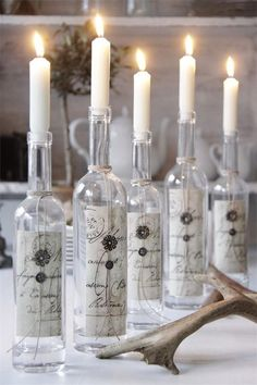 adding scrapbook paper to wine bottles and using them as interesting candle holders for an event. I think I would do something like a message in a bottle :) Bottle Candles, Bottles And Jars, Glass Bottles, Wax Candles, White Candles, Scented Candles, Non Floral Centerpieces, Wedding Centerpieces, Centerpiece Ideas