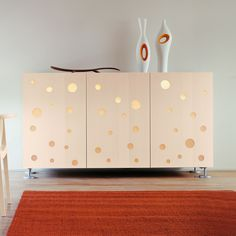 POLKA DOTS by HORM: A credenza with lights that highlight TOYO ITO's magical play with light and shadows. Available in multiple sizes and finishes.