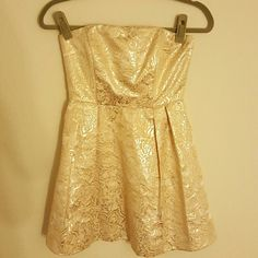 F21 metallic dress Metallic flowers. Worn once to a holiday party  I'm selling this on my instagram account @_myclosettoyours for $10 plus shipping.  I always include tracking when shipping and ship the same day or within 24 hours of me receiving payment. I have proof on my page I am not a scammer :) Forever 21 Dresses