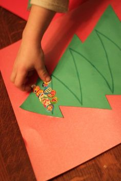 Follow the lines of garland on the Christmas tree. Use large paper and bingo daubers for toddlers