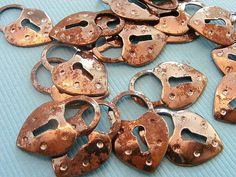 Vintage rusty heart charms are beautiful!