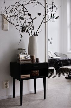 I love the shape of this nightstand. Leggy with a little drawer and a shelf for books. Simple, small, and functional.