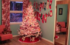 White Vintage Christmas Tree with Lots of Stockings